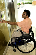 person in a wheelchair entering an elevator